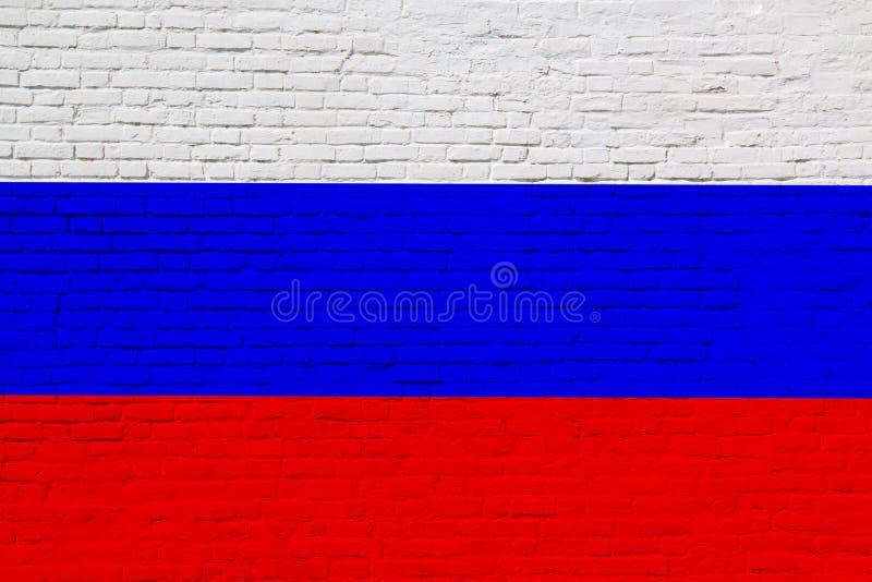 砖墙上绘有俄罗斯联邦国旗 库存照片