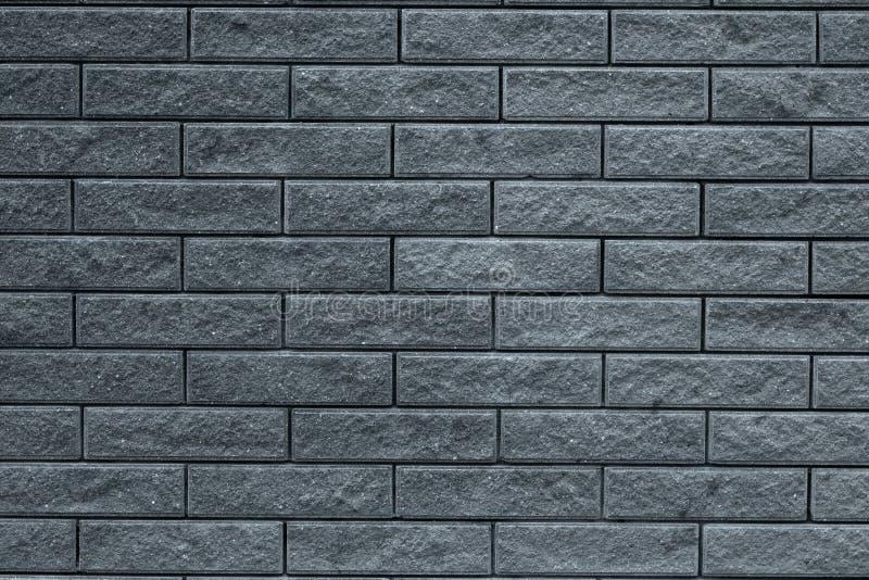 砖墙背景的抽象灰色样式 浅灰色的石背景 灰色砖构造房子facad墙纸背景  免版税库存照片