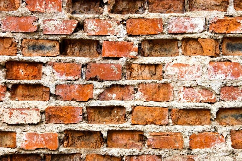 砖损坏的老非常墙壁 免版税库存照片