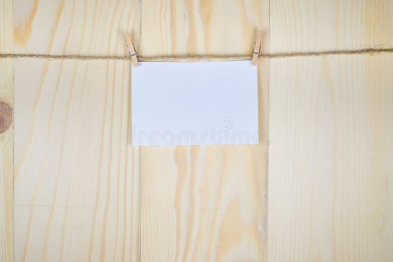 砖灰色纸棍子磁带墙壁白色 免版税库存照片