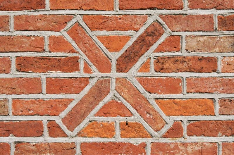 砖石造壁与一个十字架的作为装饰 免版税图库摄影