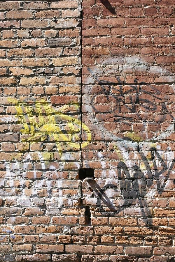 砖街道画墙壁 库存照片