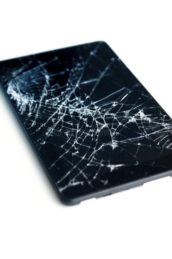 破裂的显示的图片在白色隔绝的片剂的 有损坏的屏幕的片剂 免版税库存图片