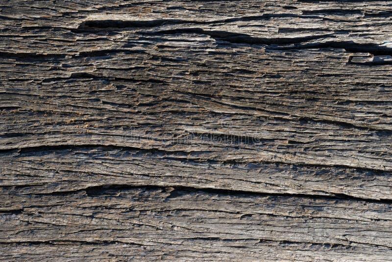 破裂的老木表面抽象纹理  图库摄影