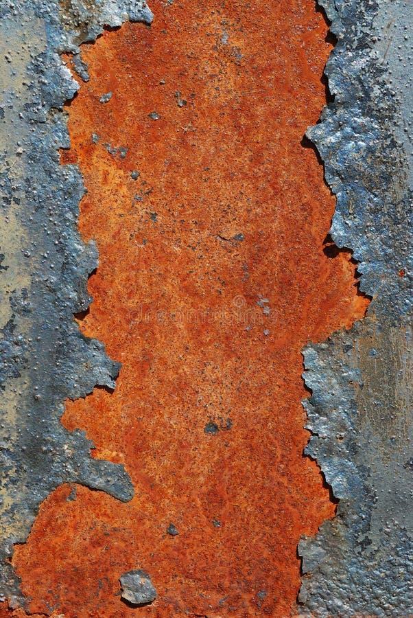 破裂的金属生锈的表面 免版税库存照片