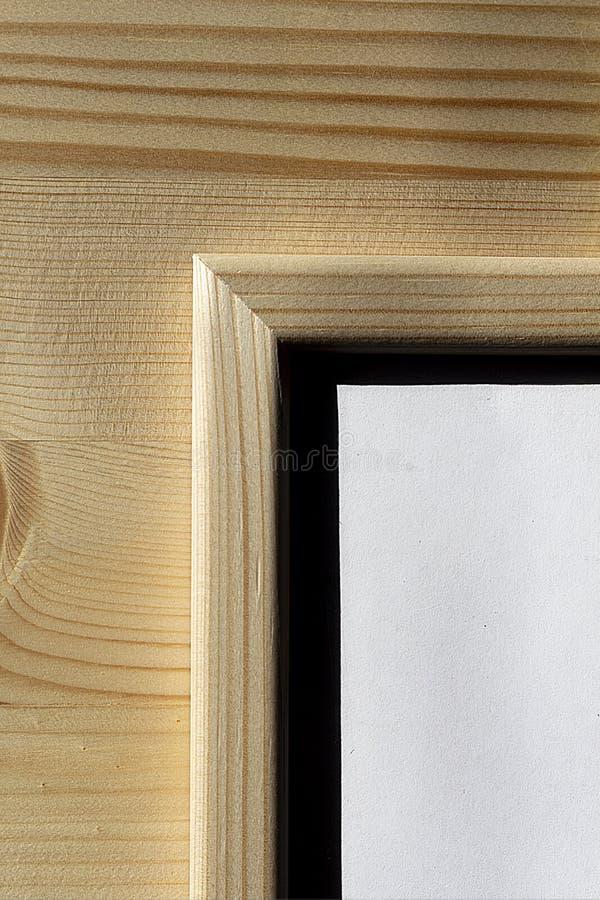 硬光,木质背景的木框 免版税库存图片