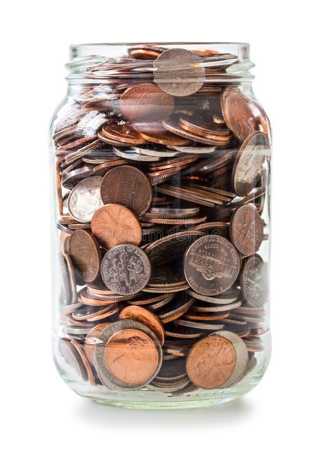 硬币充分的瓶子 免版税库存图片