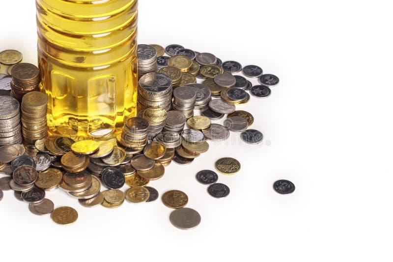 硬币和烹调用油 库存照片