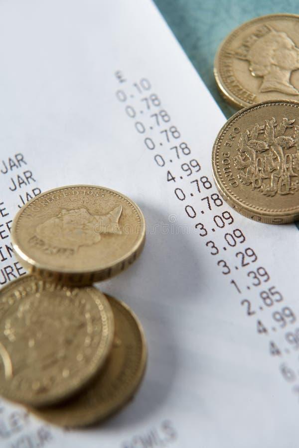 硬币开收据直到 免版税图库摄影