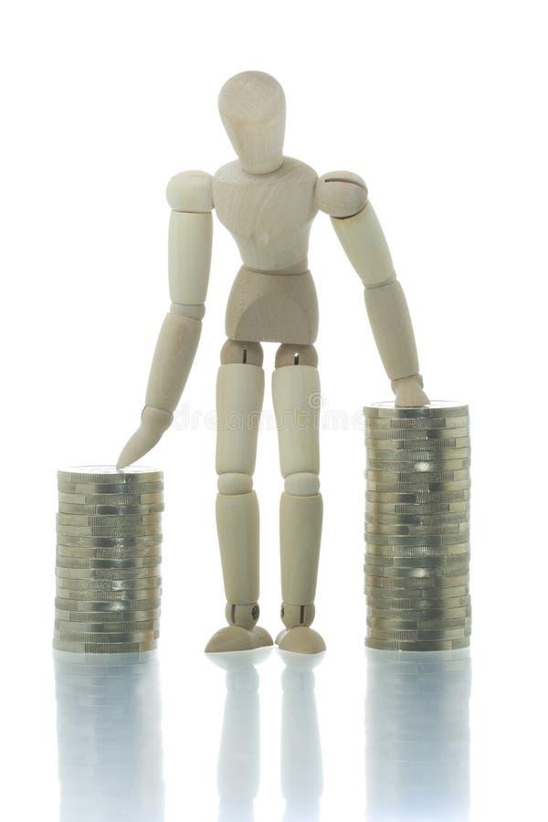 硬币突出二的人体模型堆 图库摄影