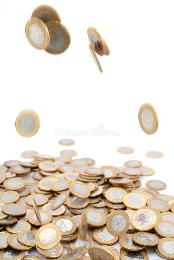 硬币落 库存照片