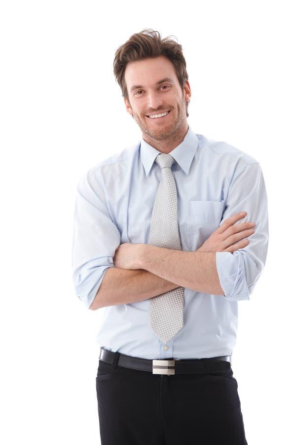 确信地微笑英俊的生意人 免版税图库摄影