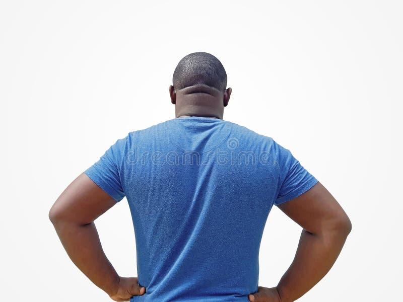 确信地站立用他的在他的腰部的手-人背面图的人有胳膊的两手插腰在白色背景 库存照片