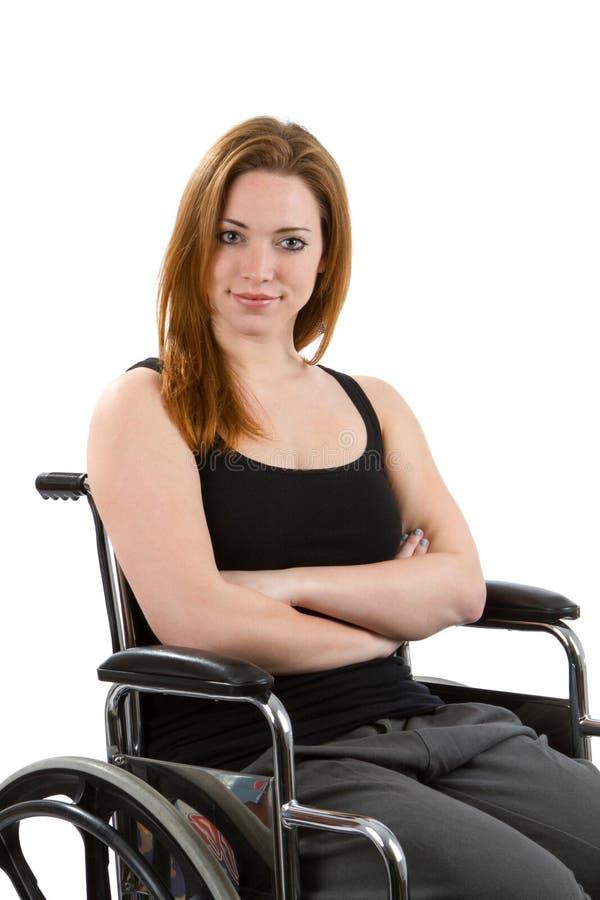 确信的妇女轮椅 免版税库存图片