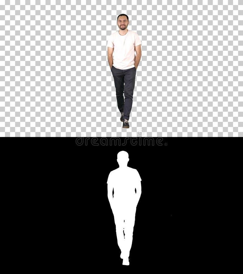 确信的年轻成人人走的前锋和看在白色衬衫,阿尔法通道的照相机 库存图片