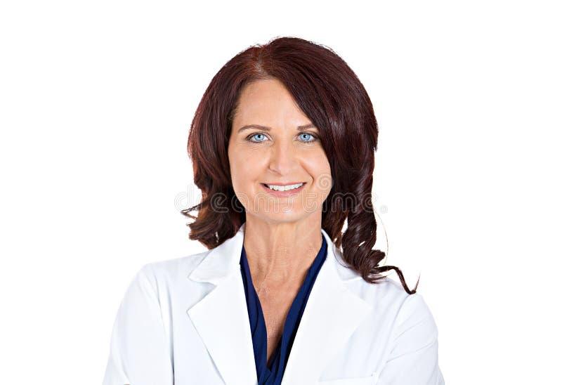 确信的愉快的微笑的女性医生药剂师 图库摄影