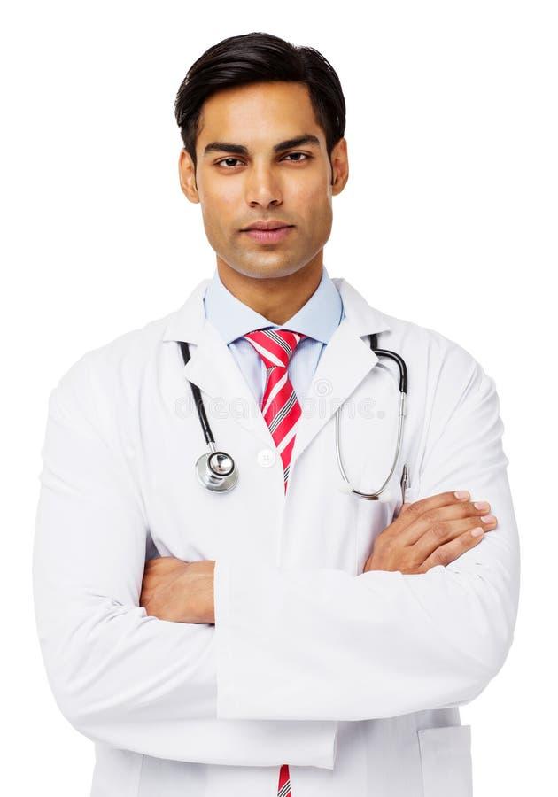 确信的男性医生With Arms Crossed 免版税库存图片