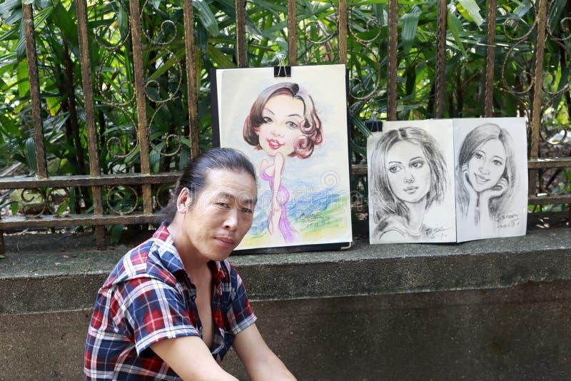 确信的街道画家 免版税库存图片
