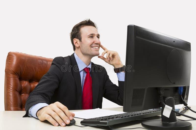 确实地微笑英俊的生意人 图库摄影