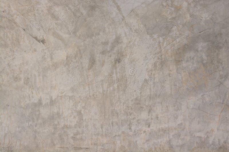 磨光水泥光滑抹灰混凝土墙的背景纹理 免版税库存图片