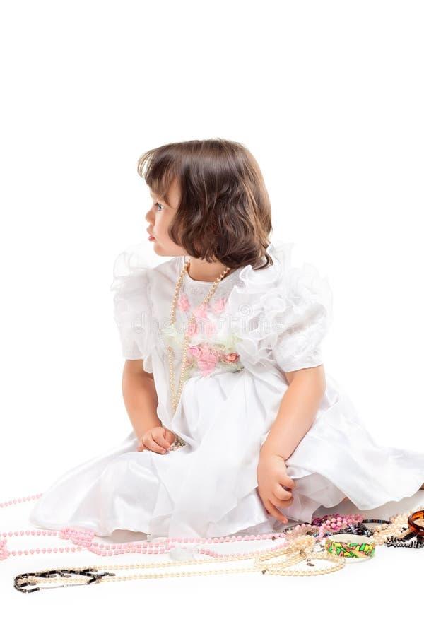礼服女孩少许相当白色 免版税库存图片