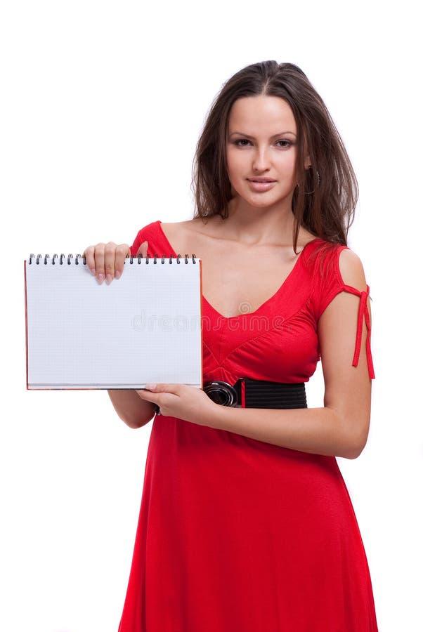 礼服女孩拿着笔记本红色 库存照片