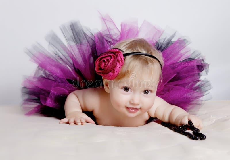 礼服女孩紫色的一点 免版税库存照片