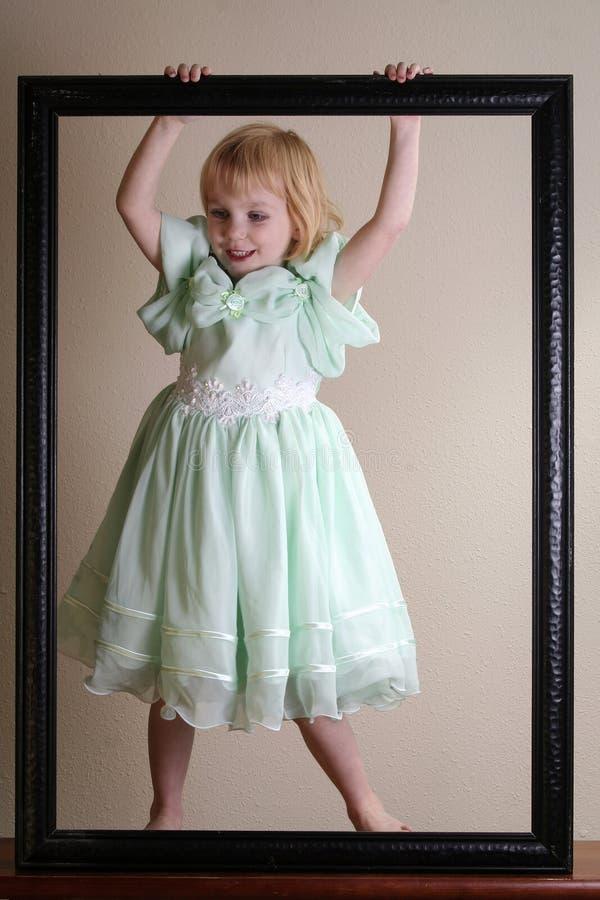 礼服愉快女孩的绿色一点 免版税库存图片