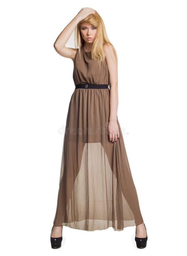 礼服的一个美丽的女孩 免版税库存图片