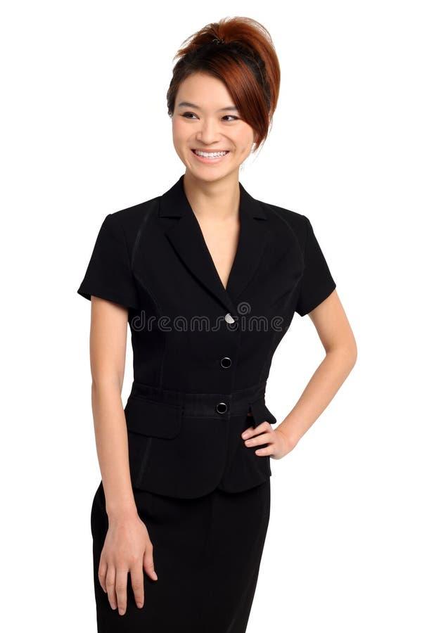 黑礼服的亚裔妇女 免版税图库摄影