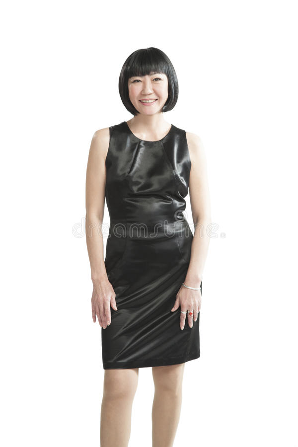 黑礼服的亚裔妇女 免版税库存图片