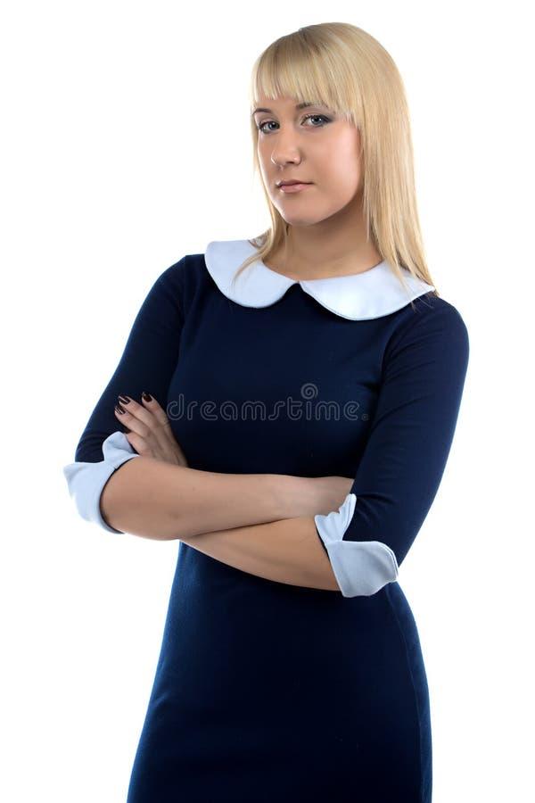 礼服的女实业家有横渡的胳膊的 免版税库存照片