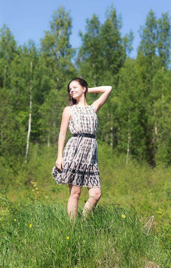 礼服的快乐的女孩 库存照片