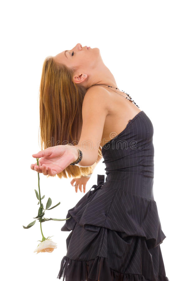 礼服的沉思女孩有玫瑰作梦的醒 库存图片