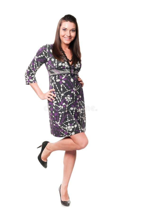 礼服的美丽的少妇 免版税图库摄影