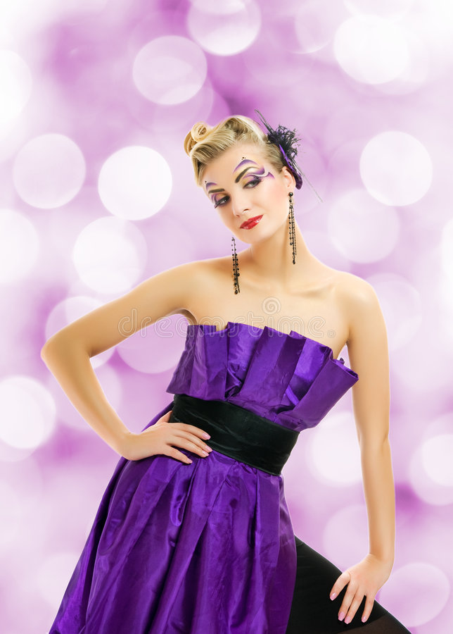 礼服紫色妇女 免版税库存图片