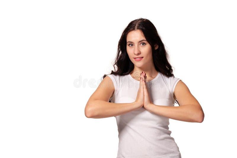 祈祷与她的手foldedand的美女的图象的关闭 免版税库存照片