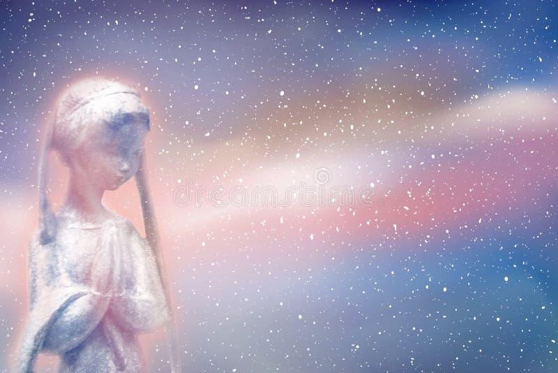 祈祷在宇宙的精神 图库摄影