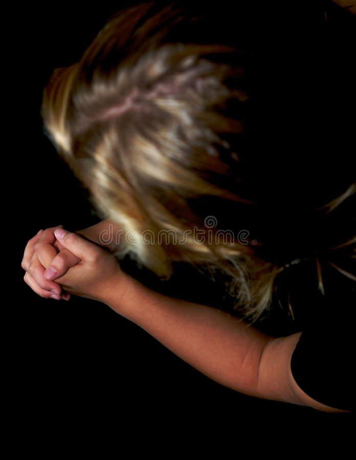 祈祷的妇女年轻人 图库摄影