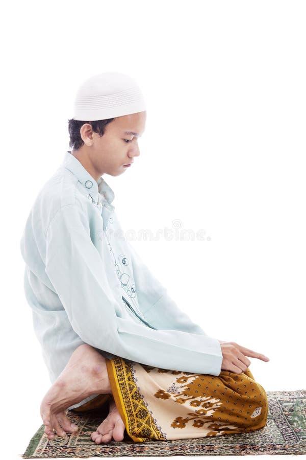 祈祷的姿势的回教人 库存图片