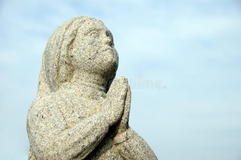 祈祷的雕象 图库摄影