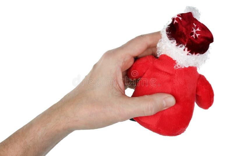 祖父在他的手上拿着红色天鹅绒手工制造圣诞老人C 库存照片