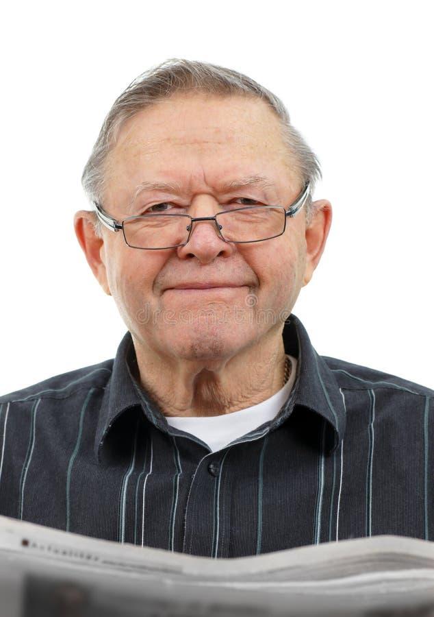 祖父报纸读取 免版税库存照片