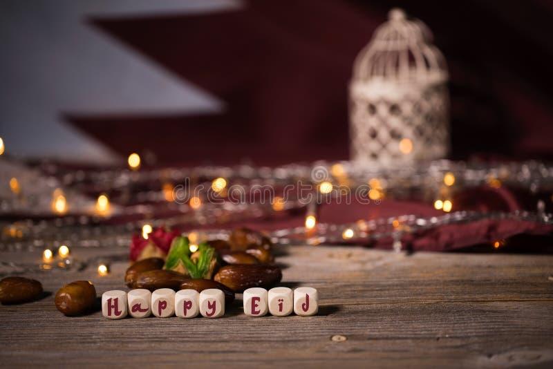 祝贺愉快的EID组成由木切成小方块 库存图片