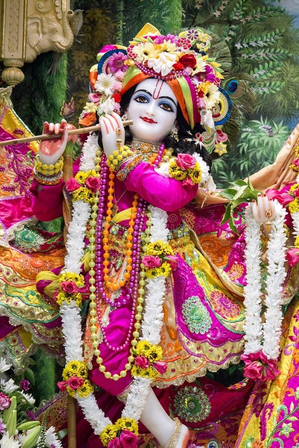 神印度krishna 明亮的五颜六色的雕刻的构成 库存照片