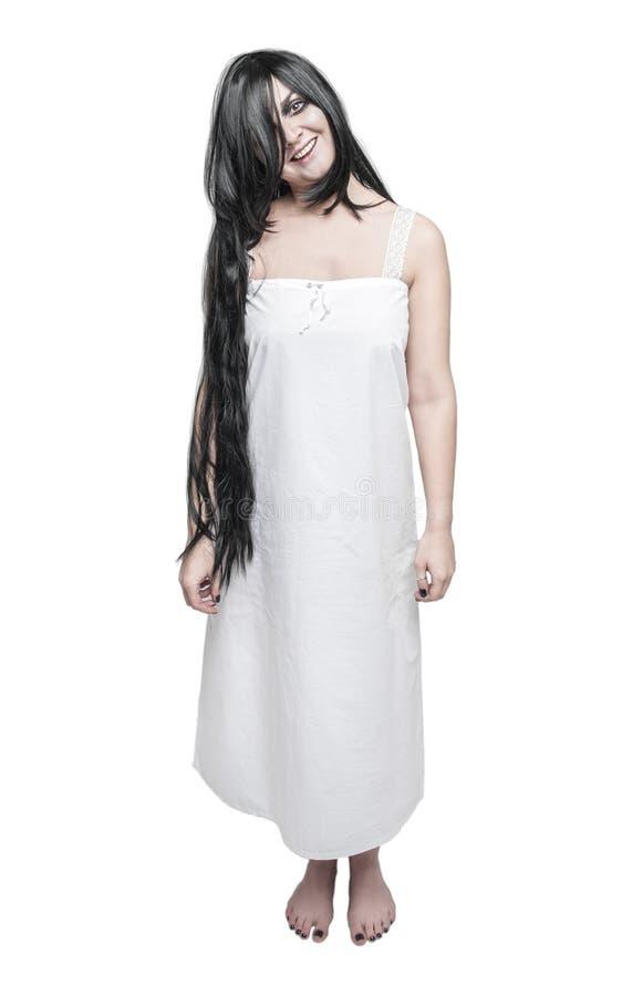 神秘的白色长的衬衣的鬼魂疯狂的妇女 免版税库存照片