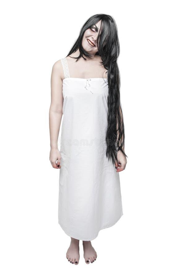 神秘的白色长的衬衣的鬼魂疯狂的妇女 免版税库存图片