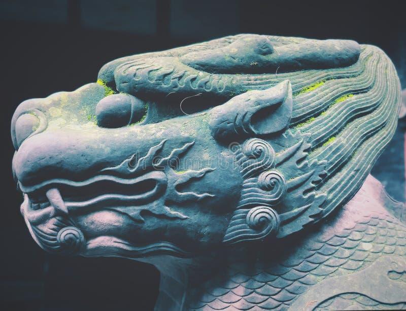 神话动物石雕塑头 免版税库存图片