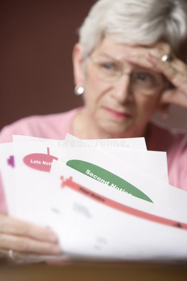 票据通知前辈妇女 库存图片