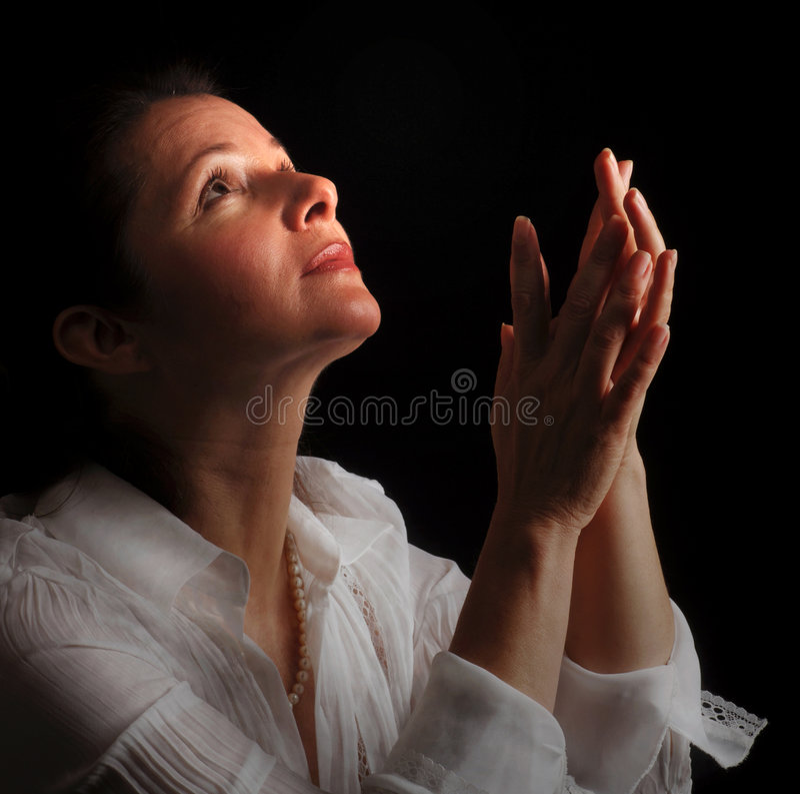 祷告妇女 库存照片